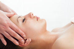 Beautiful young women getting a face massage Royalty Free Stock Photos