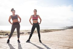 Beautiful young women getting fit together. Wearing tights and crop tops on a sunny day royalty free stock images
