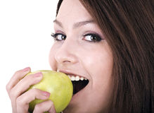 Beautiful young women with green apple. Royalty Free Stock Images