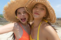 Beautiful young women have summer holiday or vacation time at beautiful beach. Pretty girls get enjoying their summer season life. Together. Asian women get stock photo
