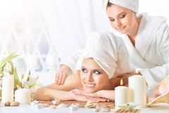 Young woman having massage Royalty Free Stock Photography