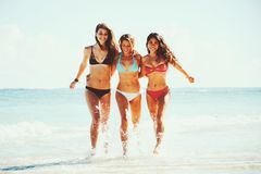 Beautiful Girls Fun at the Beach Royalty Free Stock Photography