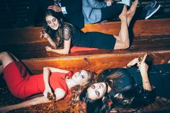 Beautiful young women having fun on crazy party lying on the flo Royalty Free Stock Images