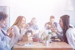 Women having lunch break. Beautiful young women having lunch break at an advert agency office royalty free stock photo