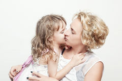 Beautiful young woman and her charming little daughter stock photos