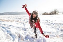 Beautiful young woman with family, having fun in the snow. Beautiful young women with her family, having fun in the snow. Sunny white winter nature Stock Photography