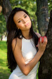 Beautiful young women holding apple in the garden Stock Photo