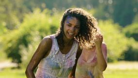 Beautiful young women hugging and smiling, water splashing on happy ladies. Stock footage stock video footage
