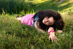 Beautiful young women lie on a grass Stock Image
