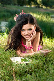 Beautiful young women lie on a grass Royalty Free Stock Photo