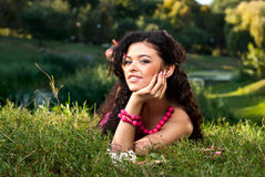 Beautiful young women lie on a grass Royalty Free Stock Photos