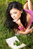 Beautiful young women lie on a grass Stock Photos