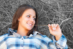 Beautiful young women lies on the pile of hay Royalty Free Stock Photo