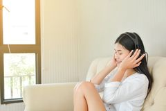Beautiful young women listening a song Stock Photography
