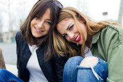 Beautiful young women looking at camera in the street. Stock Photos