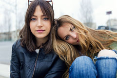 Beautiful young women looking at camera in the street. Stock Images