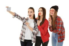 Beautiful young women with party decor taking selfie Royalty Free Stock Images