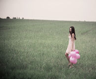 Beautiful young women with pink balloons Stock Photos