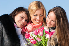 Beautiful young women with pink tulips Stock Images