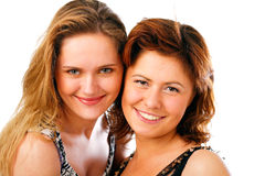 Beautiful young women posing. And smiling Royalty Free Stock Photography
