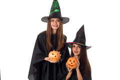 Beautiful young women with pumpkins in hands stock photography