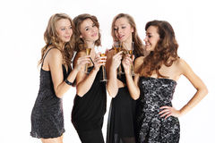 Beautiful young women in dresses toast a glass of champagne Stock Images