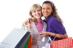 Beautiful young women shopping. Portrait of two Beautiful young women with shopping bags Royalty Free Stock Photos