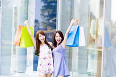 Beautiful Young Women with Shopping Bags Stock Images