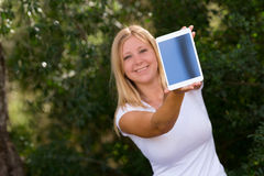 Beautiful young women showing digital tablet outdoor. Beautiful young woman showing digital tablet outdoor,selective focus Stock Photo