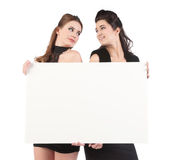 Beautiful young women with sign Stock Photos
