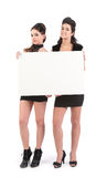 Beautiful young women with sign Royalty Free Stock Photos