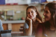 Female student in university classroom royalty free stock images