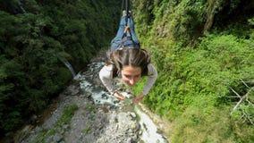 Beautiful Young Women Sliding On Zip Line
