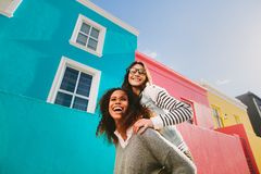 Best friends piggybacking and enjoying together royalty free stock images