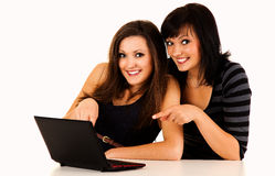 Beautiful young women studying with the laptop Stock Photography