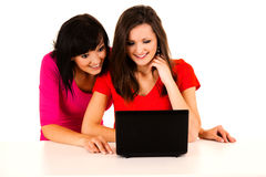 Beautiful young women studying with the laptop Stock Images