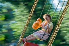 Beautiful young women swinging Stock Image
