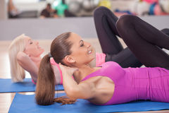 Beautiful young women are training in fitness Royalty Free Stock Image