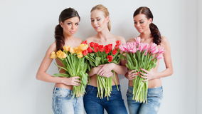 Beautiful young women with tulips stock video footage