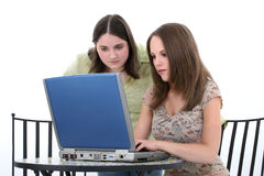 Beautiful Young Women Working Together On Laptop Royalty Free Stock Photography