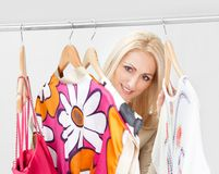 Beautiful young woomen choosing dress to wear Stock Photos