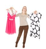 Beautiful young woomen choosing dress to wear Royalty Free Stock Image