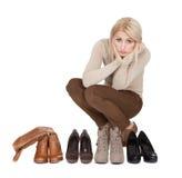 Beautiful young woomen choosing shoes to wear Stock Image