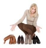 Beautiful young woomen choosing shoes to wear Stock Photos