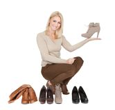 Beautiful young woomen choosing shoes to wear Royalty Free Stock Images