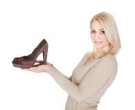 Beautiful young woomen choosing shoes to wear Stock Photography