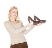 Beautiful young woomen choosing shoes to wear Stock Photo