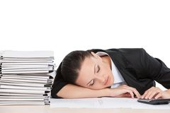 Beautiful young worker sleeping on desk. Royalty Free Stock Image