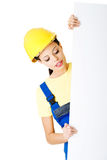 Beautiful young worker woman in protective clothes. Royalty Free Stock Images