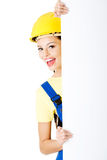 Beautiful young worker woman in protective clothes. Stock Images